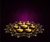 Oil lamps with place for diwali greetings over dark background — Stock Photo