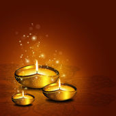 Oil lamp with plac for diwali greetings over dark background — Stock Photo