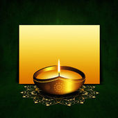 Oil lamp with place for diwali greetings over dark background — Stock Photo