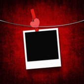 Photo hanging on clothesline with heart clothespin — Stock Photo