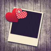 Grunge valentine background with two hearts and photo — Stock Photo