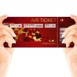 Valentine fly ticket holded by hands — Stock Photo #39277825
