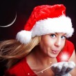 Young christmas woman holding star over dark — Stockfoto #3963778