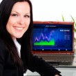 Smiling brunette businesswoman in office with laptop — Foto de Stock