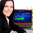 Smiling brunette businesswoman in office with laptop — ストック写真