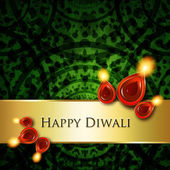 Oil lamps with diwali greetings over green  background — Stock Photo