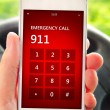 Hand holding mobile phone with emergency number 911 — Stock Photo #49166819