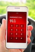Hand holding mobile phone with emergency number 911 — ストック写真