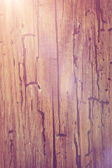 Abstract wooden background with light flare — Stock Photo