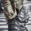 Army parade - military force uniform soldier boot row — Stock Photo