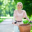 Female biker in a park — Stock Photo