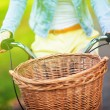 Bicycle with wicker basket - Stock Photo