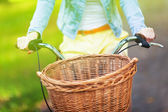 Bicycle with wicker basket — Stock Photo