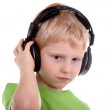 Boy listening to music with headphones — Stock Photo