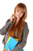 Portrait of cute girl with textbook in hands looking Isolated on white background — Stock Photo