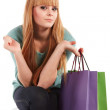Young girl with shopping bags in shop — Stock Photo
