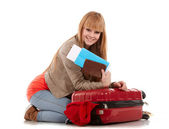 Young girl with suitcase on white — Stock Photo