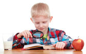Child looking through a magnifying glass — Stock Photo