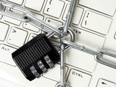 Cipher padlock on keyboard — Stock Photo