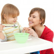 Baby boy eating — Stock Photo