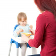 Young mother feeding hungry baby — Stock Photo #13468230