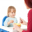 Young mother feeding hungry baby — Stock Photo #13468569