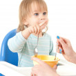 Young mother feeding hungry baby — Stock Photo #13468663