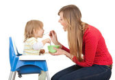 Mom giving food to her son — Stock Photo