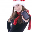 Young woman in Christmas cap with GPS — Stock Photo #3135409