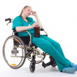 Doctor with alcohol on wheelchair — Stock Photo #3935498
