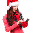 Christmas girl with phone — Stock Photo