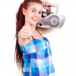 Foto Stock: Isolated smiling young girl listening to music