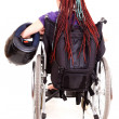 Young womwith motorcycle helmet on wheelchairr, white backgro — Stock Photo #40733235
