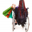 Shopping womon wheelchair — Stock Photo #40733289