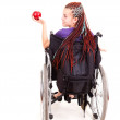 Young womon wheelchair, white background — Stock Photo #40733465