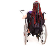 Student woman on wheelchair, white background — Stock Photo