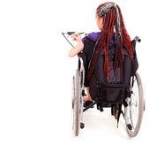Student woman on wheelchair, white background — Stock Photo
