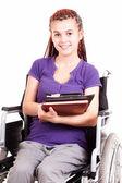 Teen woman on wheelchair, white background — Stock Photo