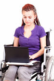 Young woman on wheelchair, white background — Photo