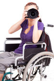 Young woman on wheelchair, white background — Stock Photo