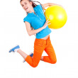 Teen girl jumping with ball white background — Stock Photo