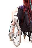 Trendy girl on the wheelchair, white background — Stock Photo