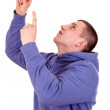 Stock Photo: Young guy pointing up, white background