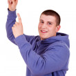 Young guy pointing up, white background — Stock Photo