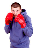 Young man in boxing gloves, white background — Stock Photo