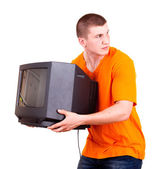 Young male with TV set, white background — ストック写真