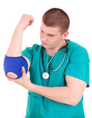 Young man doctor,elbow injury,  white background — Stock Photo