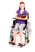 Invalid girl on wheelchair isolated on white — Stock Photo