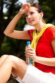 Pretty young woman resting in the park — Stock Photo