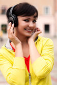 Pretty young lady listening to music — Stock Photo